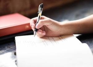字を書く仕草